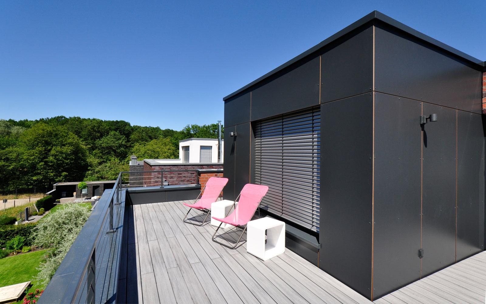 Einfamilienhaus Aufstockung Flachdach Dachterrasse